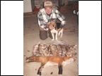 Joe Lane with 9 Rabbits and a Red Fox